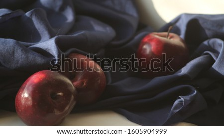 Still life with apples and drapery