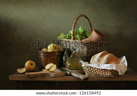 Still life with apples and fresh bread
