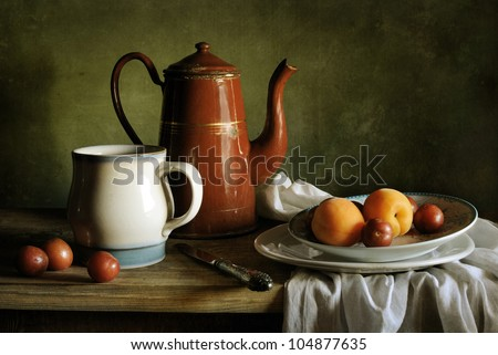 Still life with apricots and a coffee pot