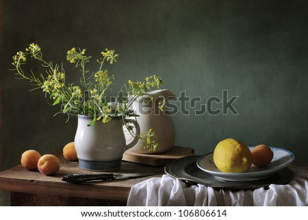 Still life with apricots and a lemon
