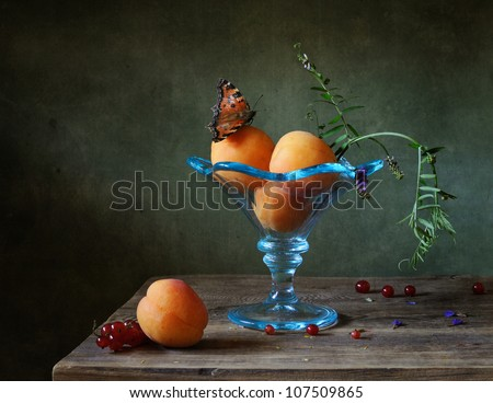 Still life with apricots in a blue bowl