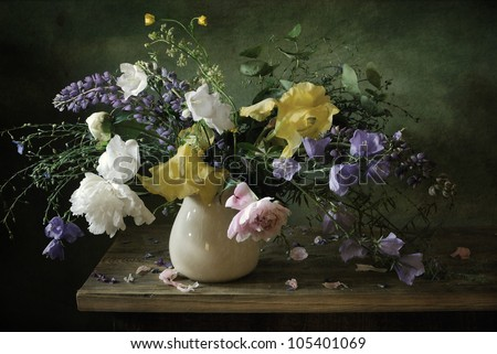 Still life with as voluptuous bouquet of flowers
