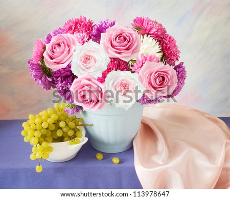 Still life with aster and roses bunch and grapes on artistic background