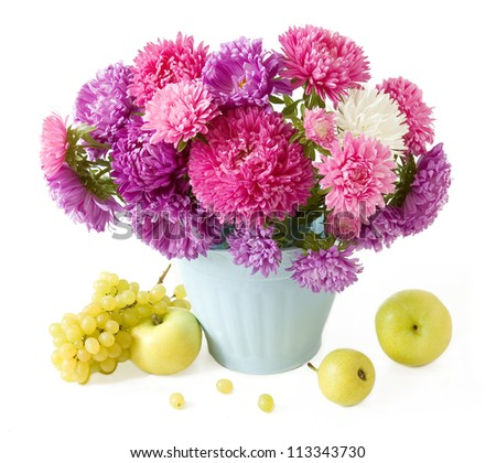 Still life with autumn flowers and fruits isolated on white background