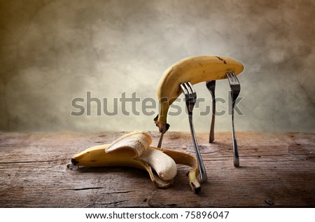 Still-Life with Banana stuck on four Forks