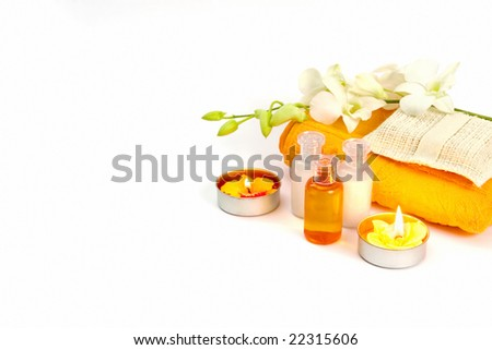 Still-life with bath and spa accessories with exotic orchid isolated on white background.