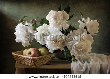 Still life with beautiful peonies and apples