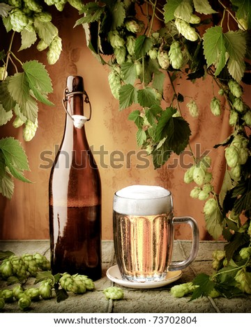 Still life with beer and hop-plant in vintage style