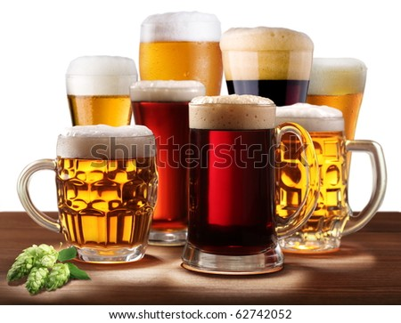 Still-life with beer glasses. On a white background.