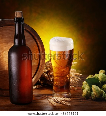 Still life with beer, wheat and hops. - stock photo