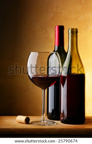 Still-life with bottle of red wine and glass