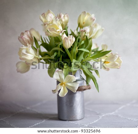 Still Life with bouquet of tulips in old milk can