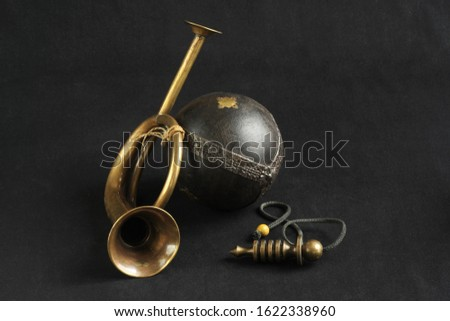 still life with brass objects and wooden ball
