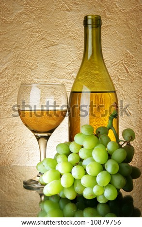 Still-life with bunch of grapes and white wine