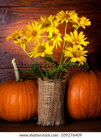 still life with bunch of yellow flowers and pumpkins #109276409
