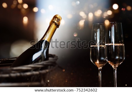 Still life with champagne and festive bokeh background