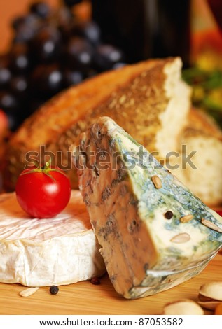 Still life with cheese and autumn fruits - stock photo