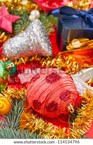 Still life with Christmas decoration balls on red background