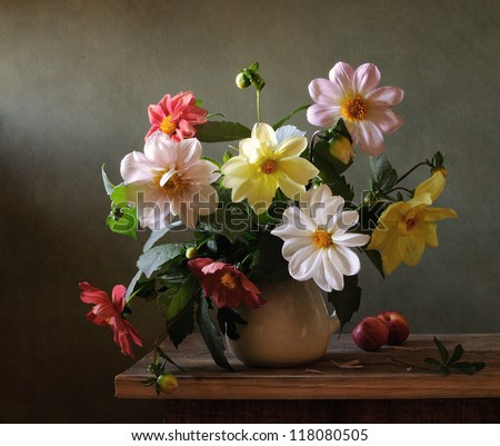 Still life with chrysanthemums and red apples