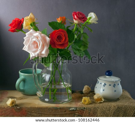 Still life with colorful roses and physalis