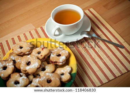 Still life with cookies and tea. Focused on cup of tea