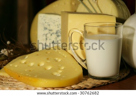 Still-life with dairy products - cheese and milk