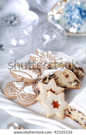 Still life with delicious Christmas cake and cookies