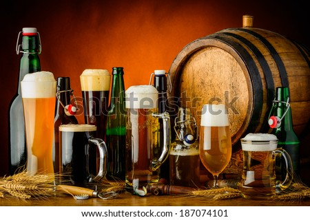 still life with different bottles glasses and mugs of beer drinks