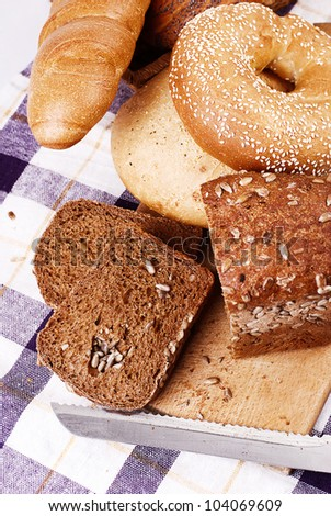 Still life with different kinds of bread on the tablecloth
