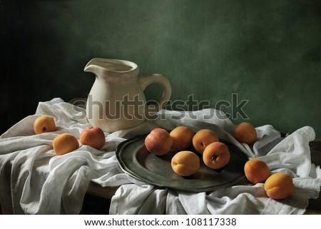 Still life with drapery and apricots