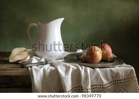 Still life with drapery and red pears