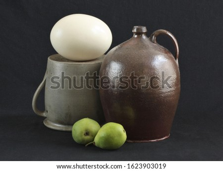 still life with earthenware, ostrich egg and pears