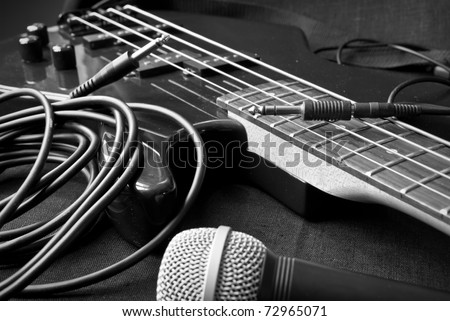 still life with electrical guitar, microphone, jacks; black and white