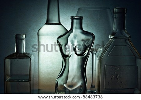 Still life with empty glass, glass in shape of woman body