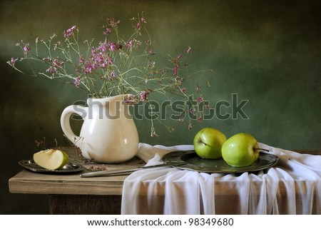 Still life with field flowers and green apples