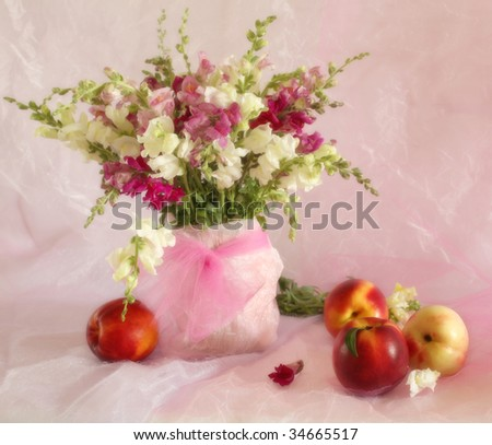 Still life with flowers and peaches in soft focus