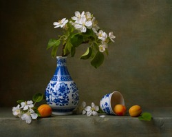 Still life with flowers of apple and apricots