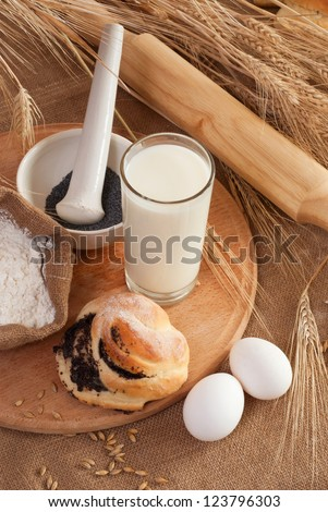 still life with Fresh buns and egg, milk