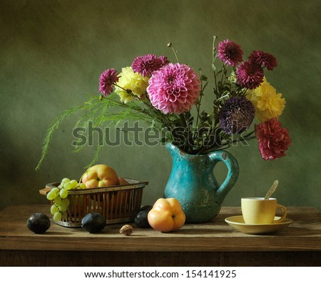 Still life with fruit and a bunch of flowers