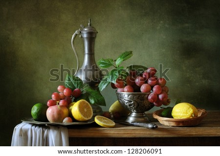 Still life with fruit and a tin jar