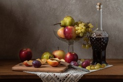 Still life with fruit. Apples Grapes Pears and Plums.