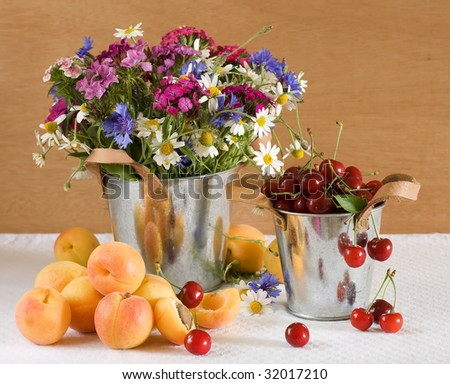 Still life with fruits and wild flowers