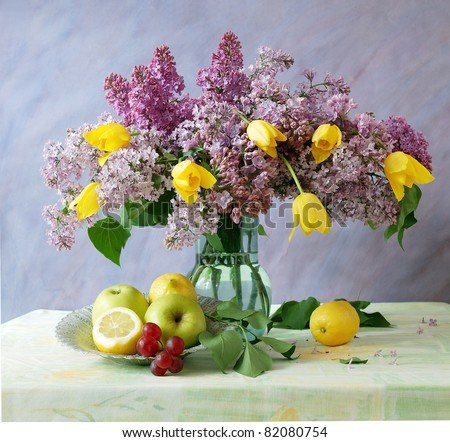 Still life with fruits ans huge bunch of lilac and tulips