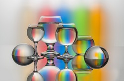 Still life with glass objects on a multicolored background