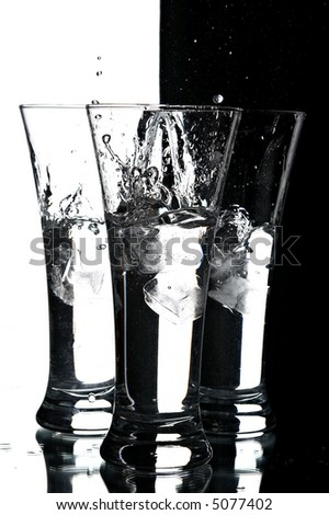still life with glasses on the white and black background