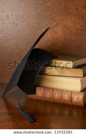 Still life with graduation cap and books