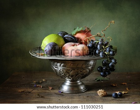 Still life with grapes and pomegranate