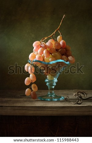 Still life with grapes in a blue bowl