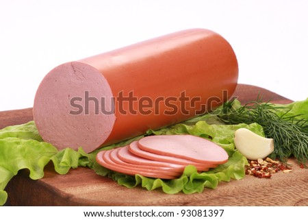 Still Life with ham on a wooden table isolated on white background.