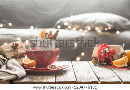 still life with home Christmas decor in the living room on a wooden table, the concept of celebration and home comfort